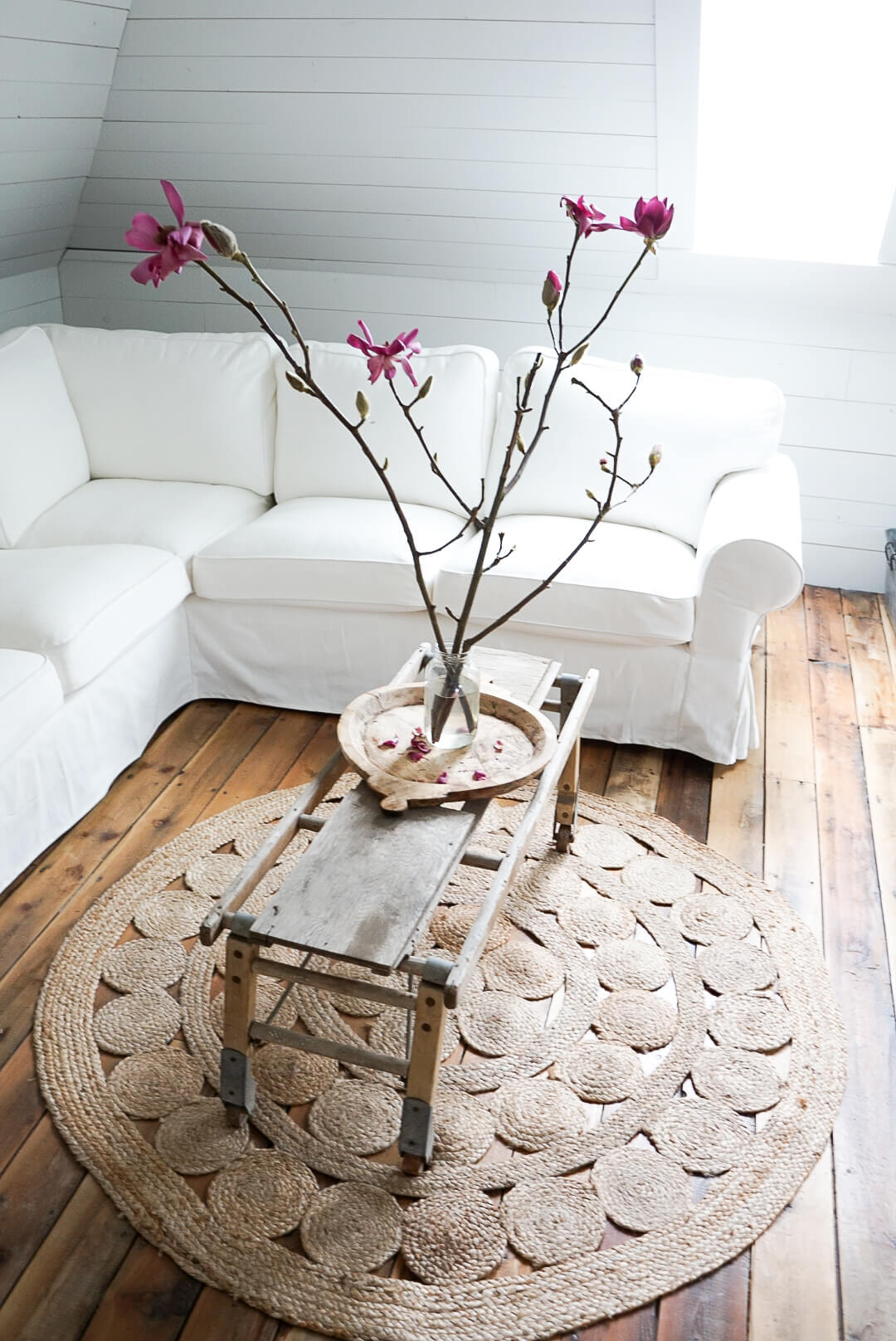 Simple-flower-decor-living-space-white-couch-minimalist