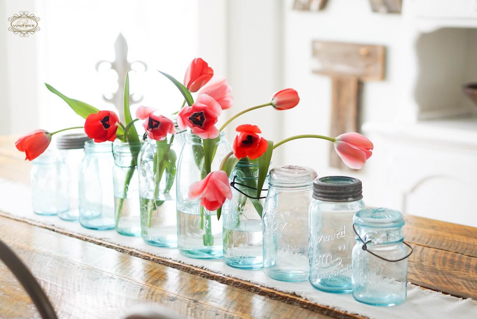 early spring trip flowers on table runner in blue vintage mason jars