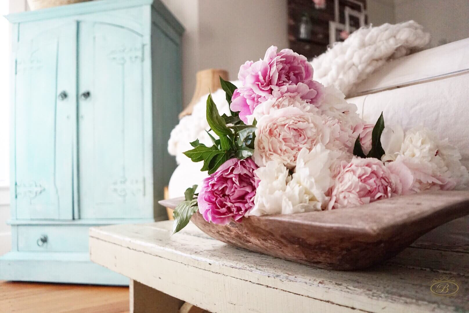 early spring flowers peonies in a dough bowl