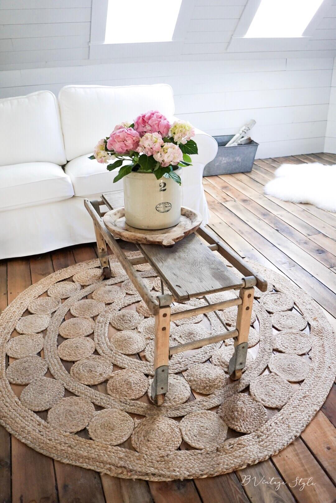 salvaged coffee table crock full of flowers for farmhouse coffee table decor