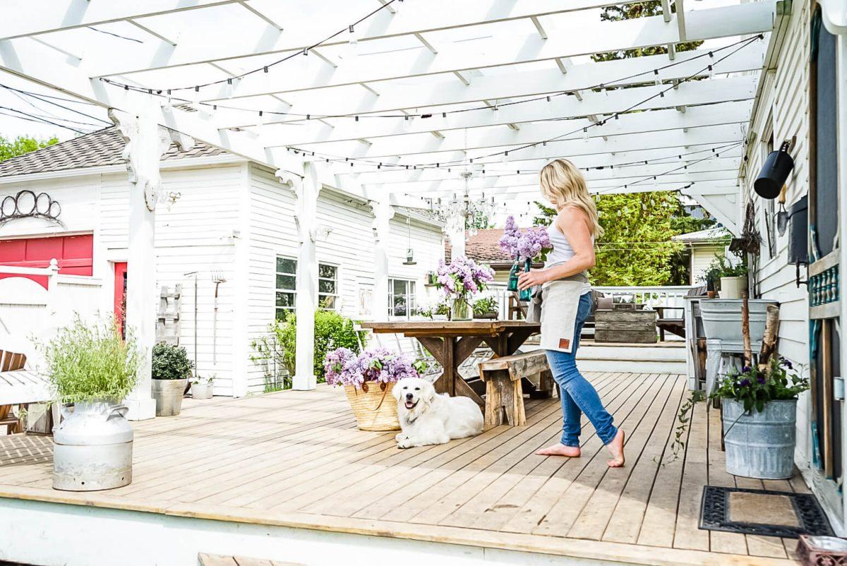 deb on back deck placing lilac bundles
