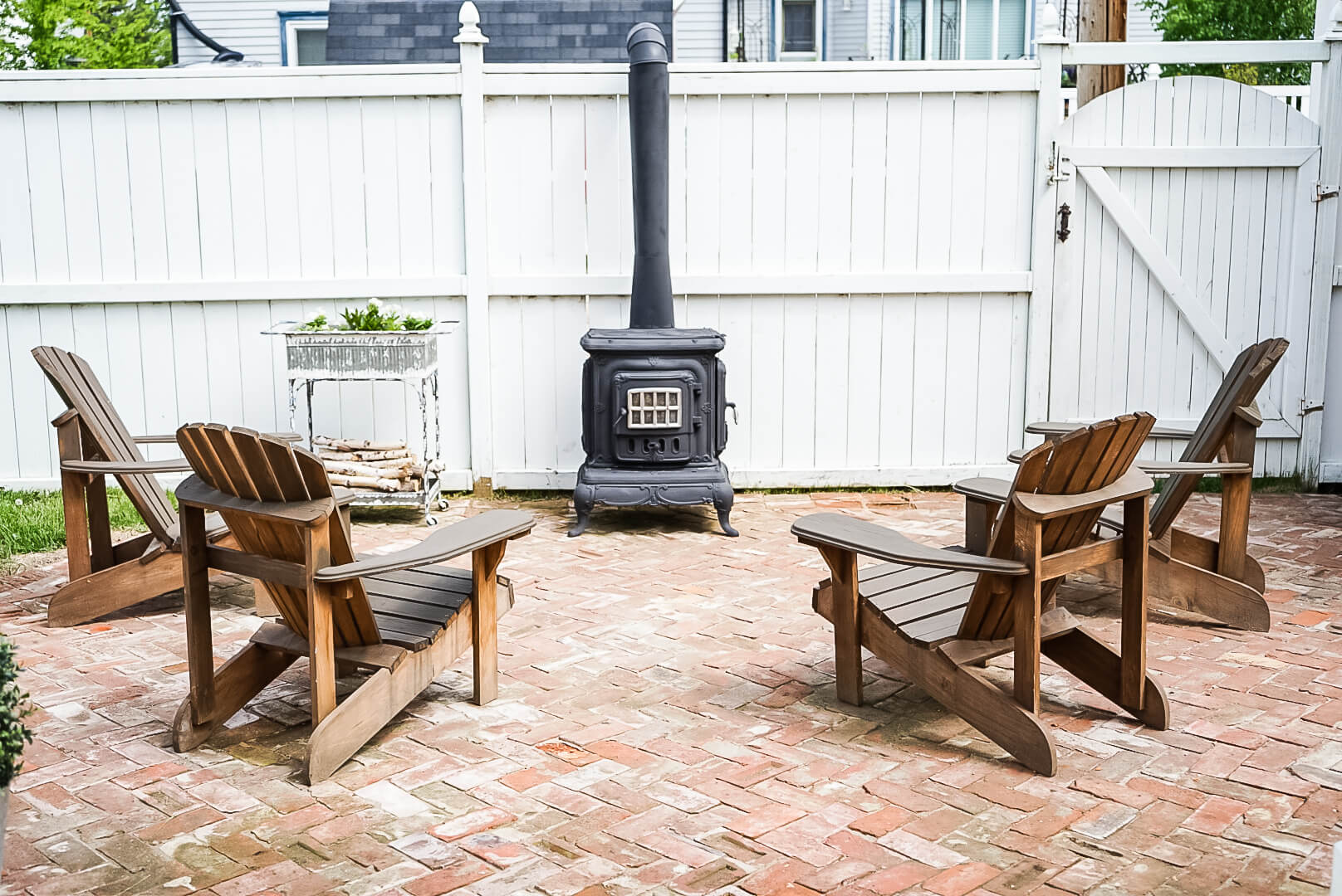sitting area for an outdoor wood burning fireplace