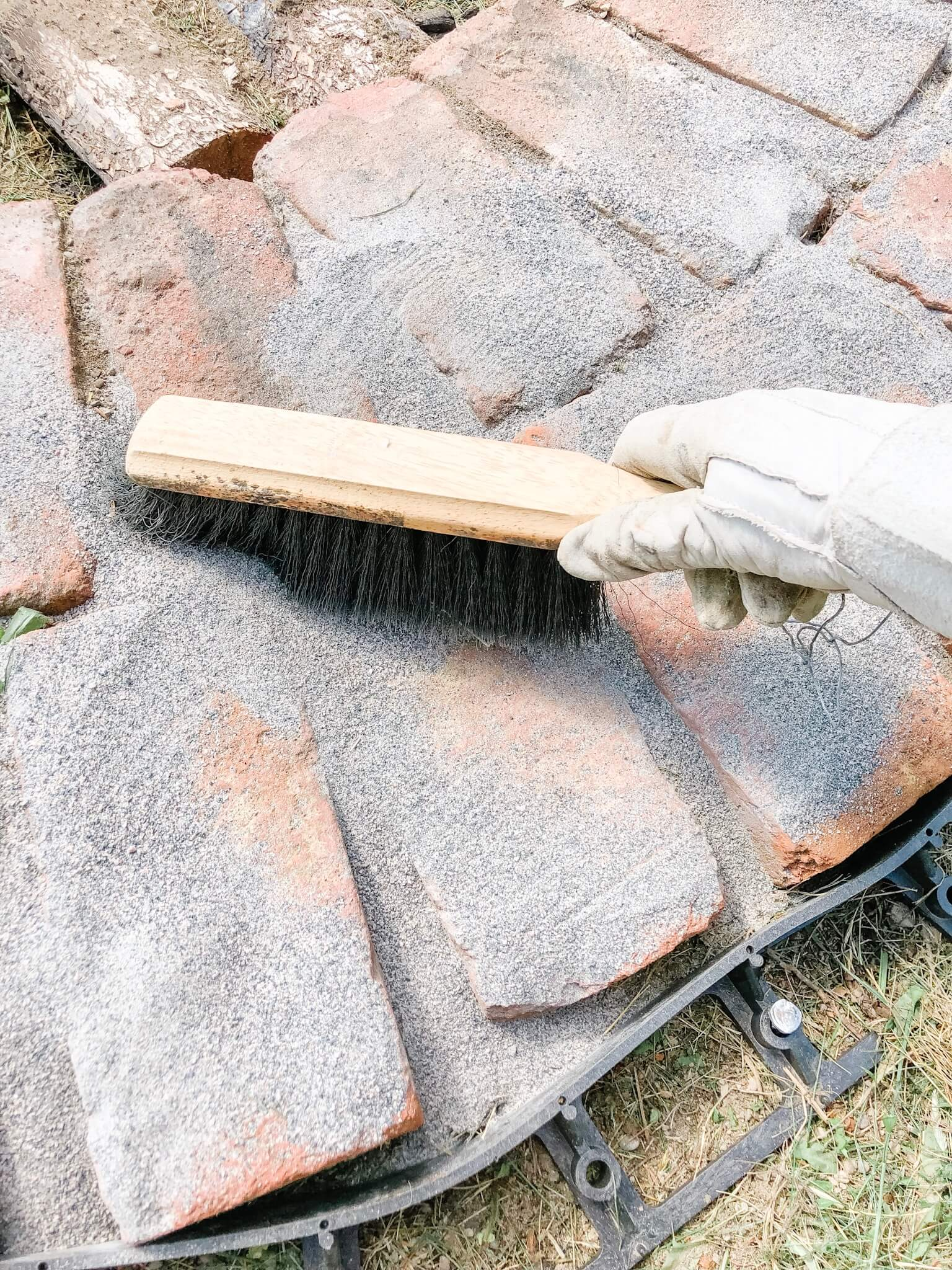 sweep the polymeric sand into the little cracks