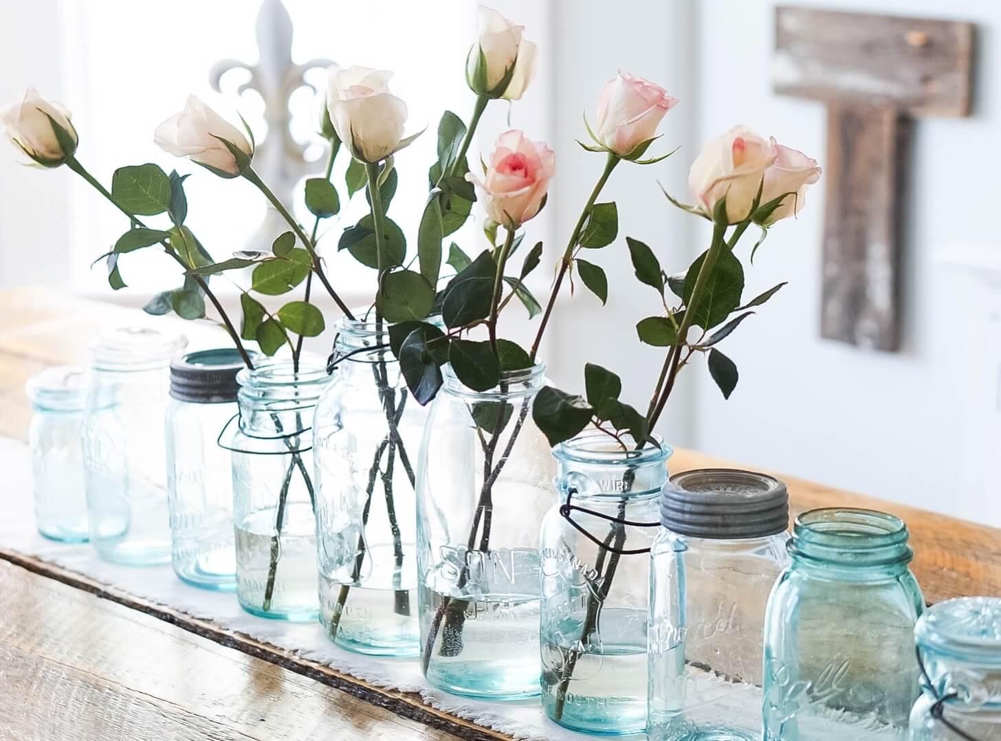 Pink-Roses-in-vintage-jars
