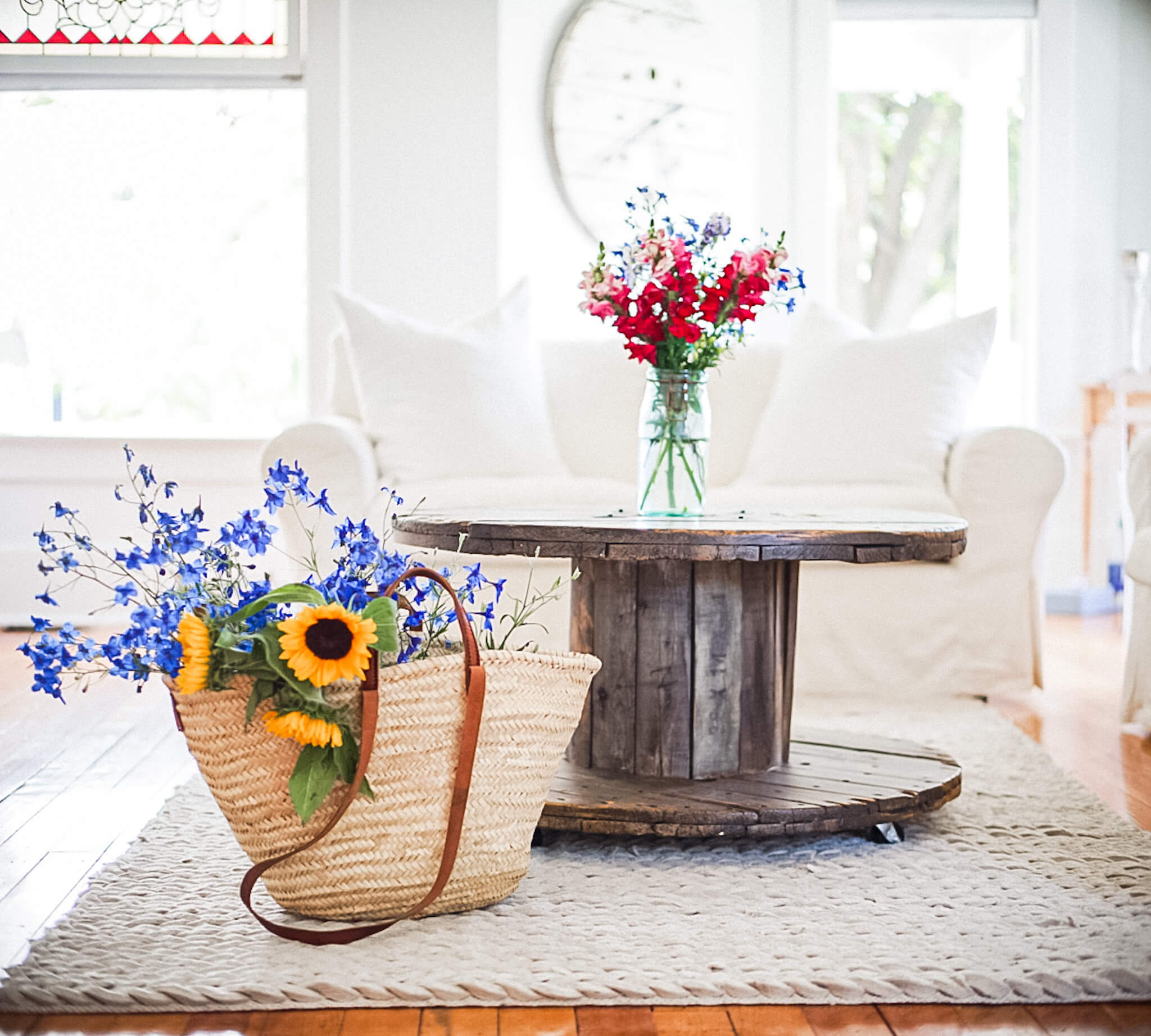 Spool farmhouse coffee table market basket full of fall flowers