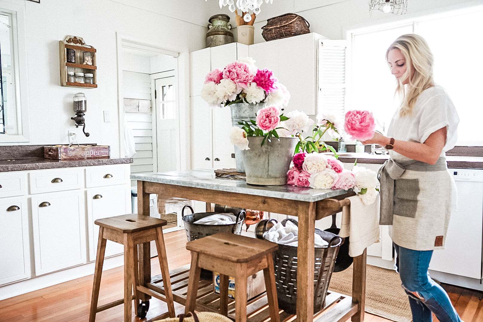 cutting fresh peonies in a farmhouse kitchen enjoying the little things