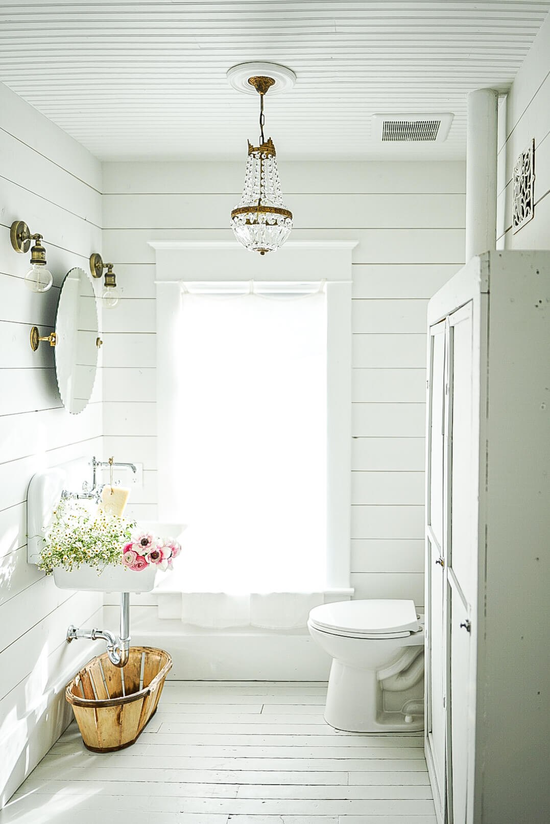 white shiplap barthroom with french antiques