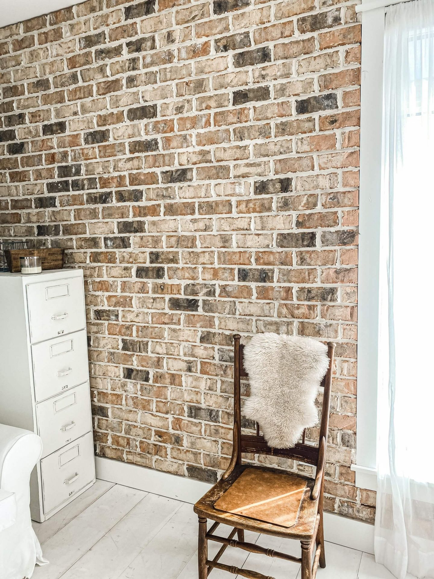 WCRP brick wall with vintage chair and sheep skin rug in photo studio