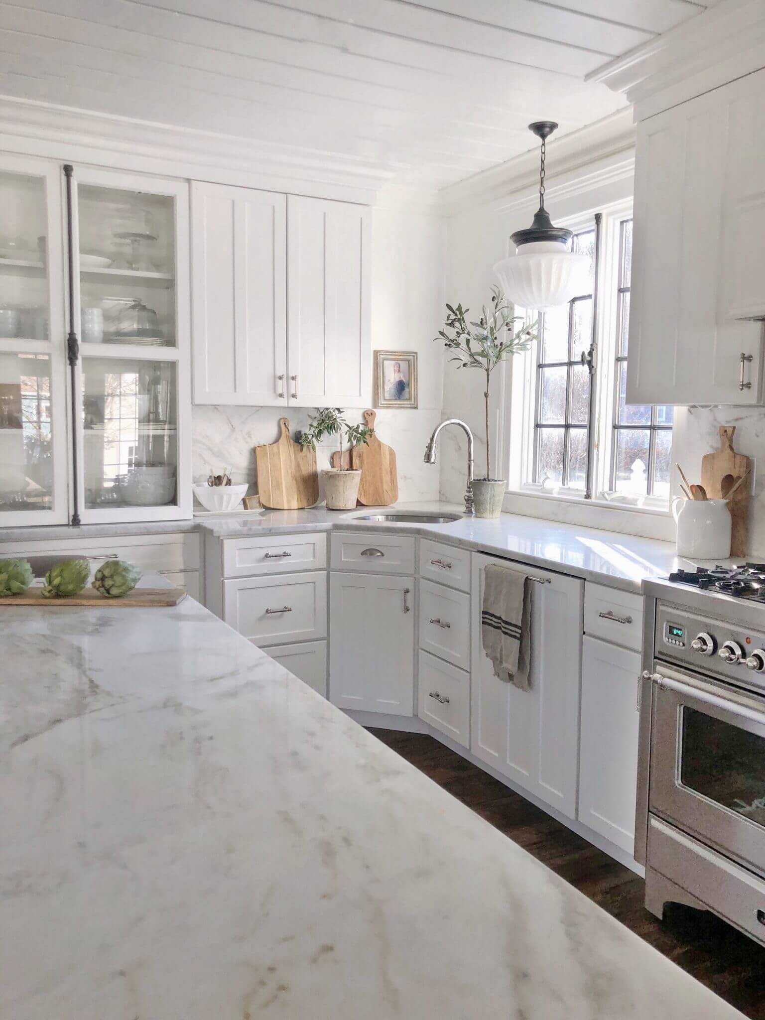 Featherglass farmhouse kitchen sink marble counter tops white cabinets