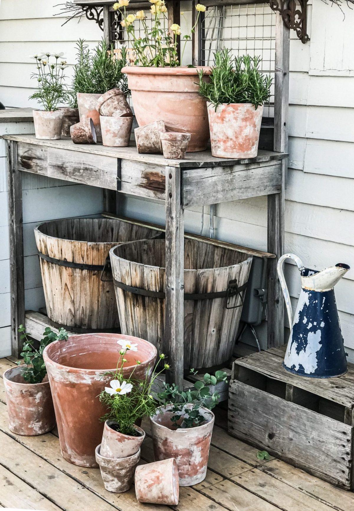Deb's diy aged terra cotta flower pots on her potting bench