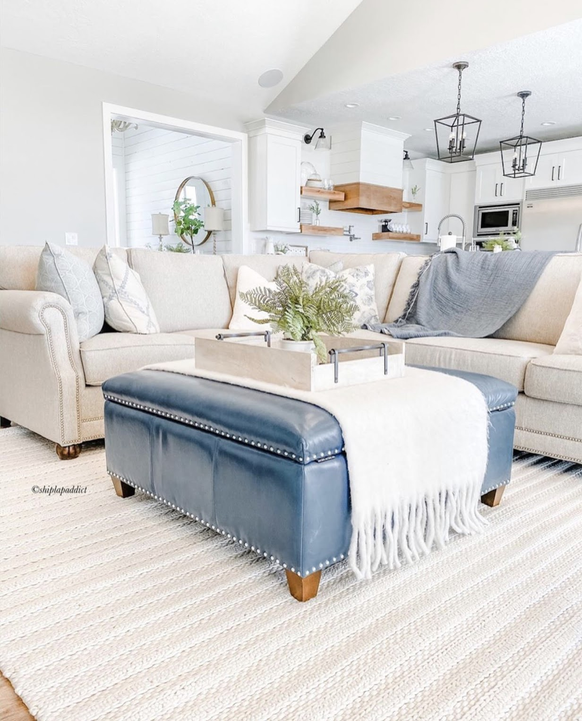 white farmhouse living room decor blue foot stool coffee table layered whites
