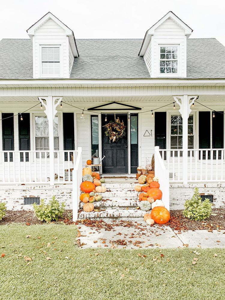 We lived Happily Ever After home tour front step with pumpkins